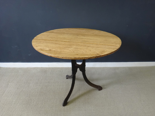 Antique wood table with cast iron base