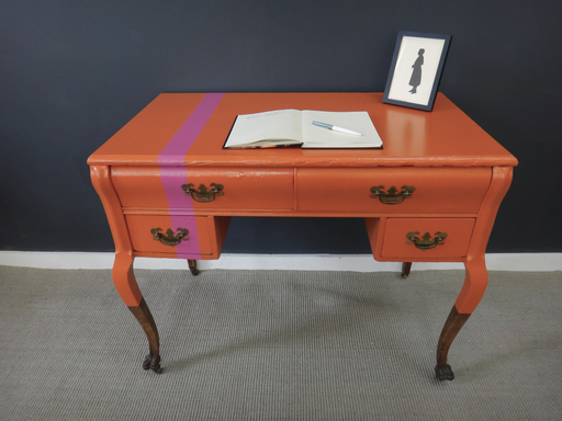 Antique oak vanity painted orange with pink stripe